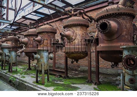 Old Rusty Industrial Containers In Abandoned Chemical Factory