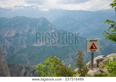 At The Top Of The Mountain There Is A Sign Warning Of The Danger Of Falling From A Height.