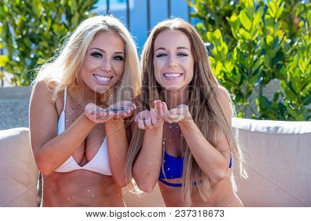 Two friends enjoying each others company in an outdoor environment with glitter