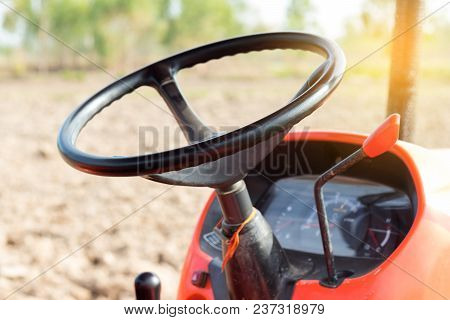 Steering Wheel Agricultural Tractor. Tractor Transportation Automobile.