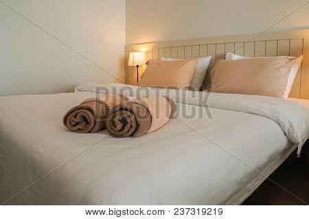 Clean Cute Towels On Luxury Double Bed In Hotel Bedroom
