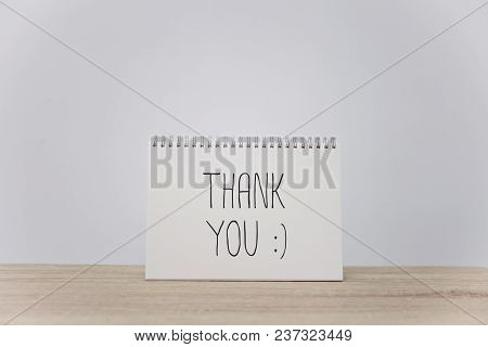 Thank You With Mock Up Of Blank Paper On Table