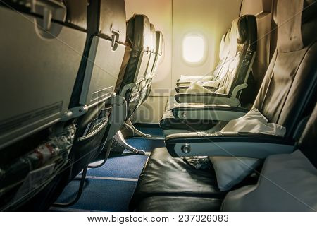 Airplane Seat And Window Inside An Aircraft. Inside The Cabin Plane . Seats In Economy Class.