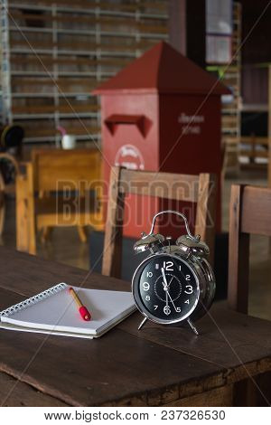 Vintage Alarm Cock And Paper Notebook, Stock Photo