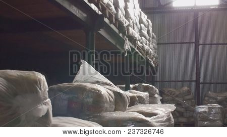 Shelves Of Cardboard Boxes Inside A Storage Food Warehouse, Wide Angle