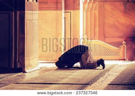 The Muslim Prayer For God In The Mosque. Old Iranian Muslim Is On His Knees Praying. Holy Month Of R