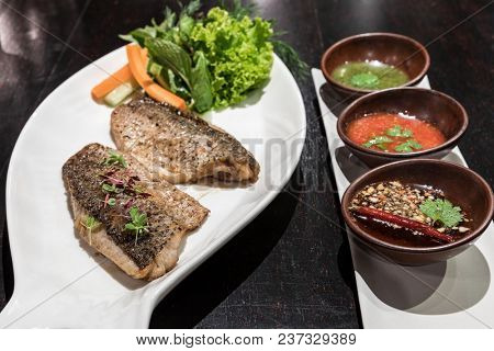Grilled sea bass served with fresh vegetable