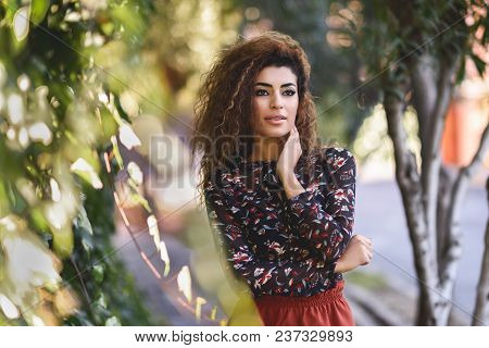 Beautiful Young Arabic Woman With Black Curly Hairstyle.