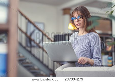 Young attractive woman in the library