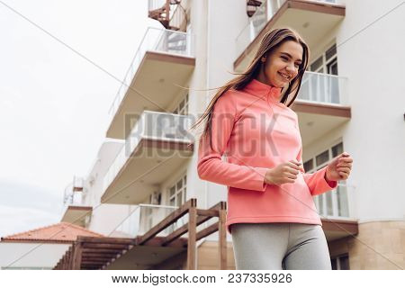 Happy Active Girl Running Around In The Open Air, Doing Sports And Leading A Healthy Lifestyle