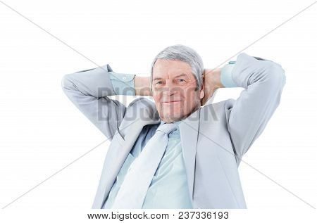 Nice Businessman At The Age, Arms Folded Behind His Head. Isolated On A White Background.
