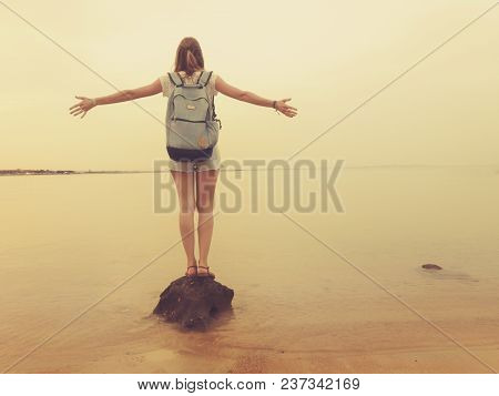 Girl With Arms Wide Open Enjoying Sea / Ocean Scenery.