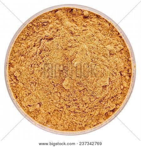 raw organic dried camu camu fruit powder (Myciara Dubia) in an isolated  Petri dish - rainforest superfruit from Peru rich in vitamin C