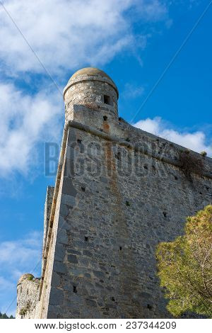 Detail Of The Doria Castle (1164-xix Century) With A Sentry Box On A Clear Blue Sky, In Porto Venere