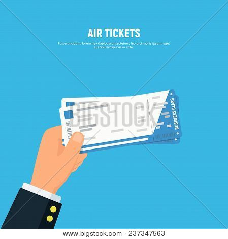 Close-up Businessman Hand Holding Air Boarding Tickets. Airline Boarding Tickets Business Class. Tra