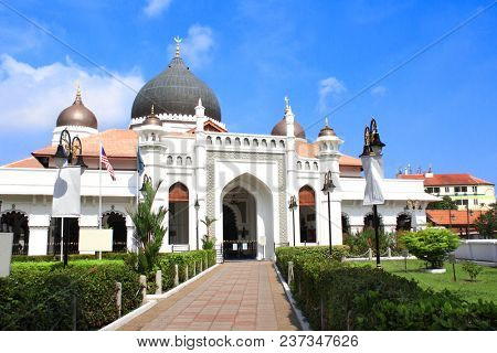 Kapitan Keling Mosque, Georgetown, Penang island, Malaysia. On blue sky background