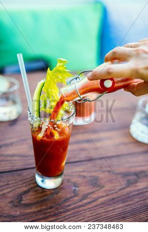 Close up of Bloody Mary cocktail served in a bar or restaurant