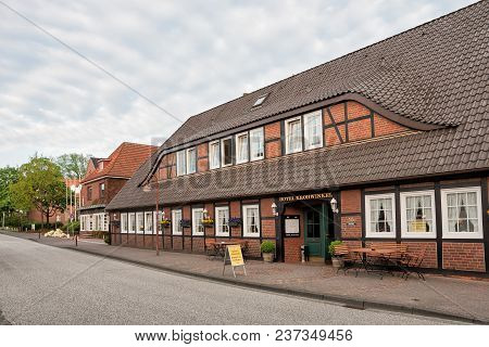 Hittfeld, Germany - May 11, 2013: Cosy Hotel In A Quiet Provincial German Town In The Early Spring M