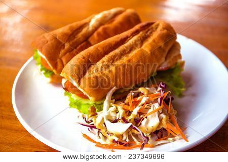 French Baguette With Salad On Plate. Rich Breakfast In European Style. Tasty Yummy Baguette. Sandvic