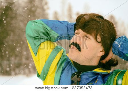 Vintage Photo Of Young Man Snowboarder In The Mountains. Retro Style. 1980 Concept. Toned.