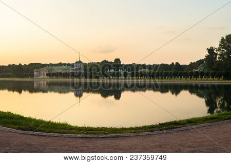 Glossy Mirror Surface Of Palace Pond In The Sunset Light. Ensemble Of The State Reserve Museum Kusko