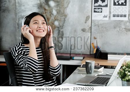 Young Asian Woman Wearing Headphones Smiling With Happiness While Working, Work At Home, Casual Offi