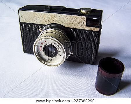 Old Film Camera And A Roll Of Film