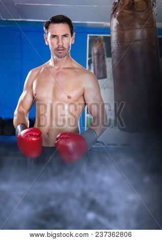 Boxer fighter man with transition and punch bag