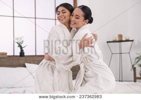 Lgbt Community. Positive Lesbian Couple Hugging Each Other While Being In A Spa Salon