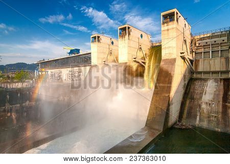 Draining Water With Rainbow Creating From The Hydroelectric Dam.