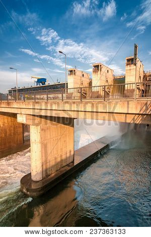A Draining Water From The Hydroelectric Dam.