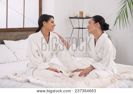 Lesbian Partners. Happy Attractive Woman Looking At Her Partner While Being In The Spa Salon Togethe