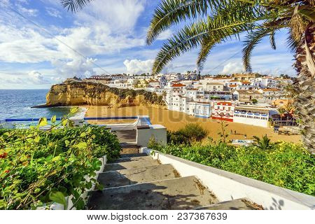 Stairs Leading To Sandy Beach From Cliffs In Carvoeiro, Algarve, Portugal