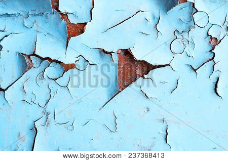 Texture Background Of Blue Peeling Paint On The Wooden Texture Surface. Closeup Of Blue Peeling Pain