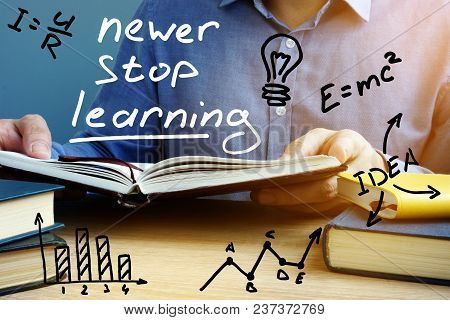 Never Stop Learning. Man Holding Open Book.
