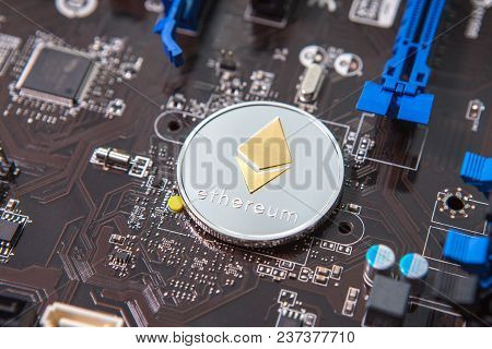 Coin Ethereum On The Background Of A Microcircuit. Crypto Currency Etherium Close-up. Mining. Crypto