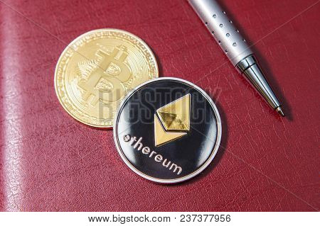 Crypto Currency, Coin Bitcoin Close-up, Coin Ethereum Close-up, On A Red Background. The Handle Is C