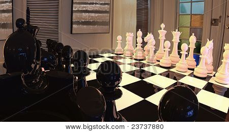 Dramatic View On A Chess Set On A Reflective Board.