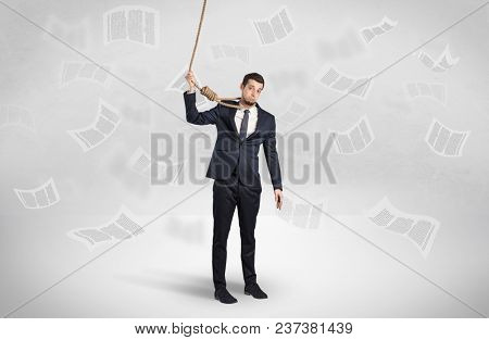 Young burnout businessman with flying documents concept