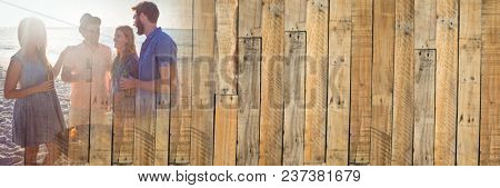 Millennials at bbq on beach with flare and wood panel transition