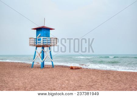 Mediterranean Beach With Vintage And Lonely Lifeguard Wooden Tower, De La Cala Beach, Malaga, Spain