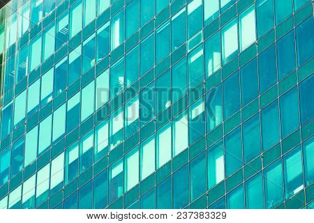 Glass Windows With Architectural Inserts Texture Of The Abstract Greenish Shade With A Glare Of Ligh