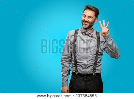Middle age man, with beard and bow tie raising finger, is the number three