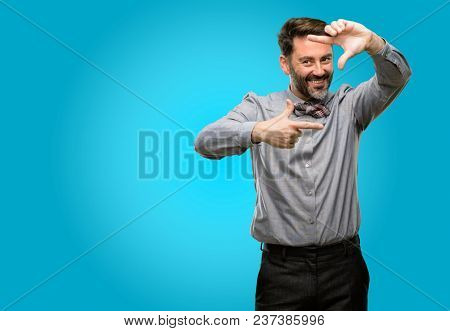 Middle age man, with beard and bow tie confident and happy showing hands to camera, composing and framing gesture