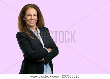 Middle age business woman with crossed arms confident and happy with a big natural smile laughing