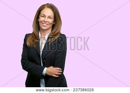 Middle age business woman confident and happy with a big natural smile laughing