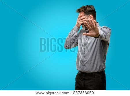 Middle age man, with beard and bow tie stressful and shy keeping hand on head, tired and frustrated