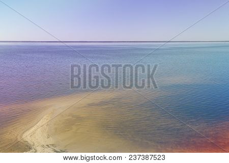 Sandy Shoreline And Sandbanks In The Water.