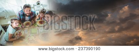 Overhead of family at table with evening sky transition