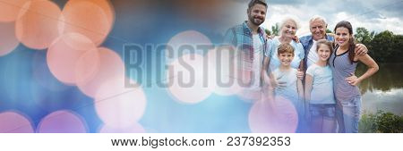 Family smiling with blue orange bokeh transition